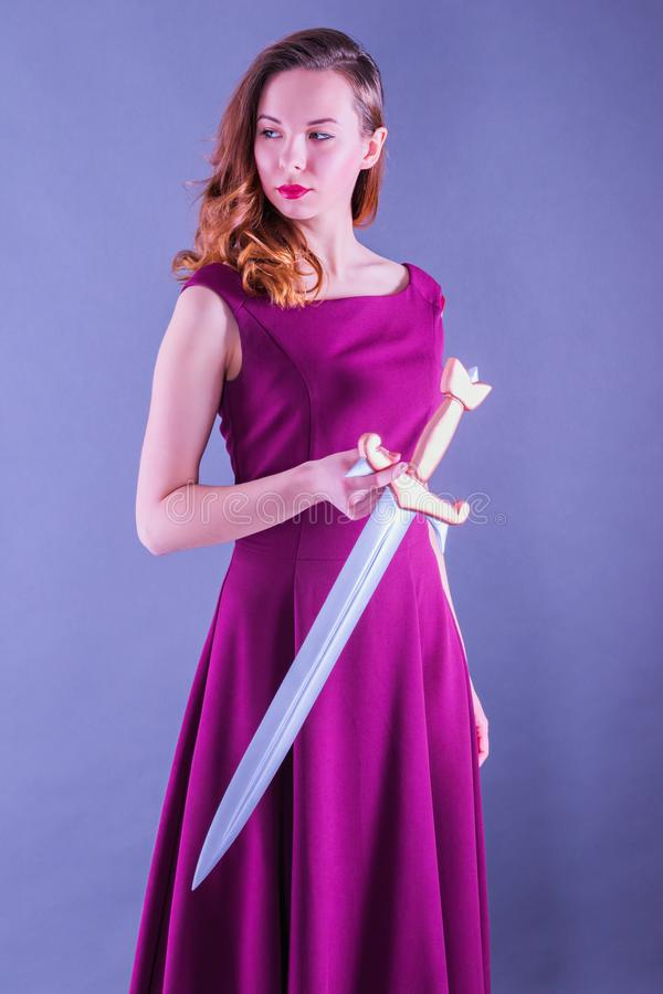 Beautiful young pure princess girl with a sword royalty free stock images