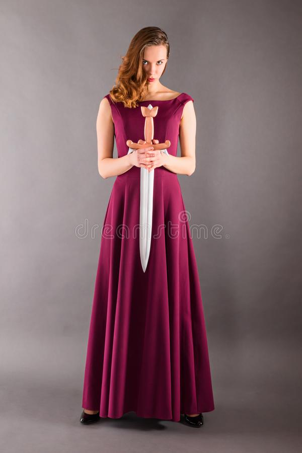 Beautiful young pure princess girl with a sword stock photography
