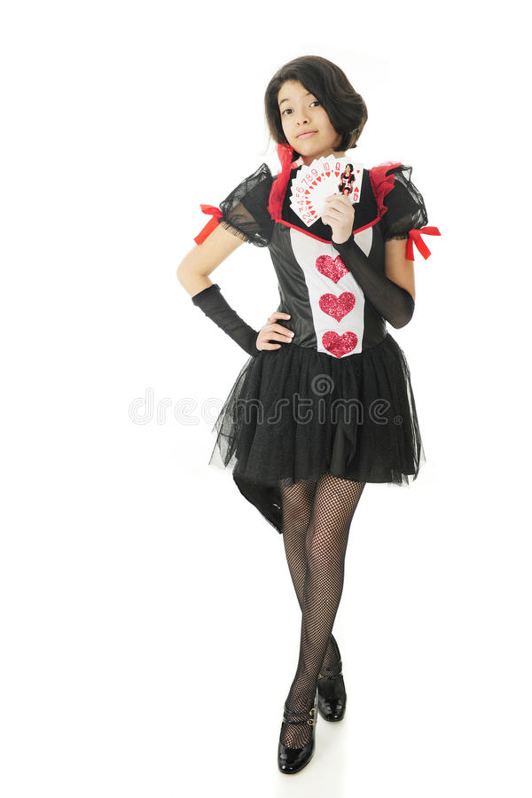 Beautiful Young Queen of Hearts. A beautiful young teen in a red, black and white Valentine dress holding all the hearts of a deck of cards with the queen ( royalty free stock photography