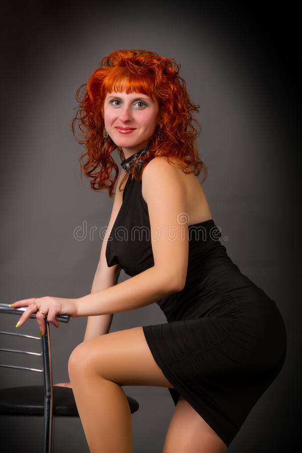 Beautiful young red-haired girl royalty free stock photography