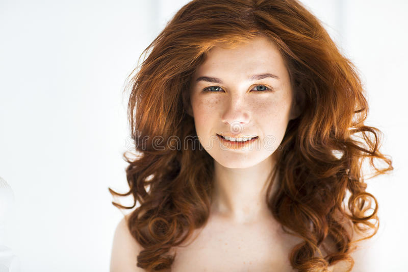 Beautiful young redhead woman with freckles portrait stock photo