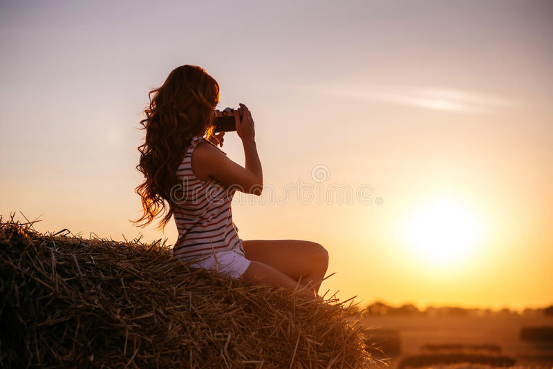 Beautiful young redhead woman with vintage camera royalty free stock image