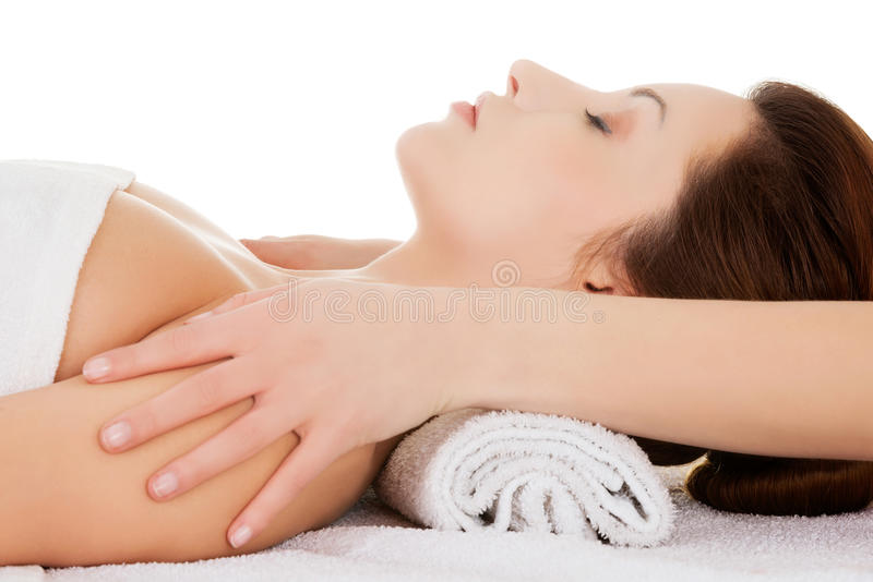 Beautiful young relaxed woman enjoy receiving face massage at sp stock images