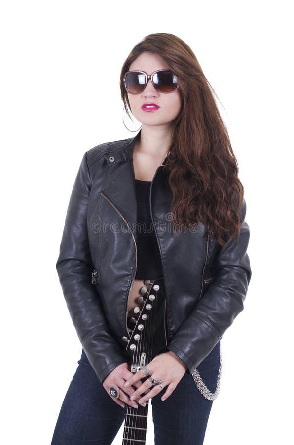 Beautiful young rocker girl wearing leather stock photos