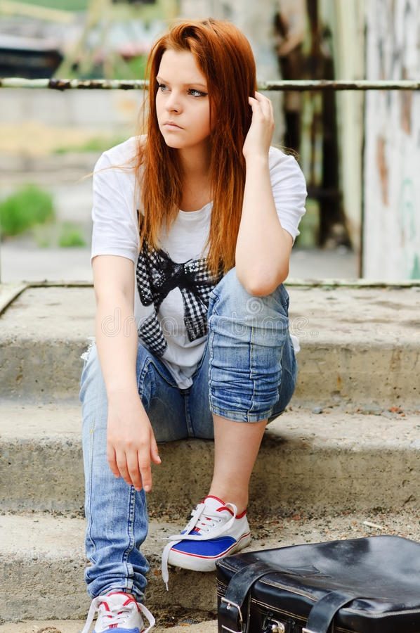 Download Beautiful Young Sad Girl Sitting On Staircase Stock Photos - Image: 21341583