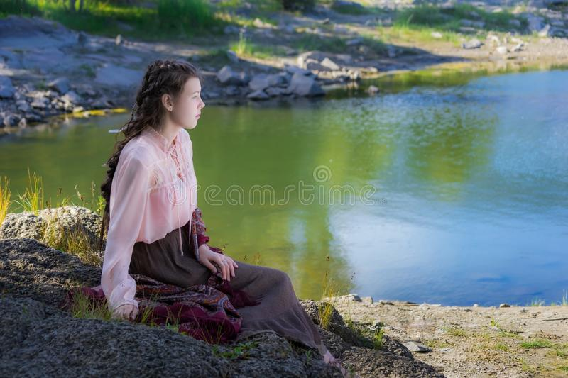 Beautiful young sad woman, dressed in the style of Boho royalty free stock photography