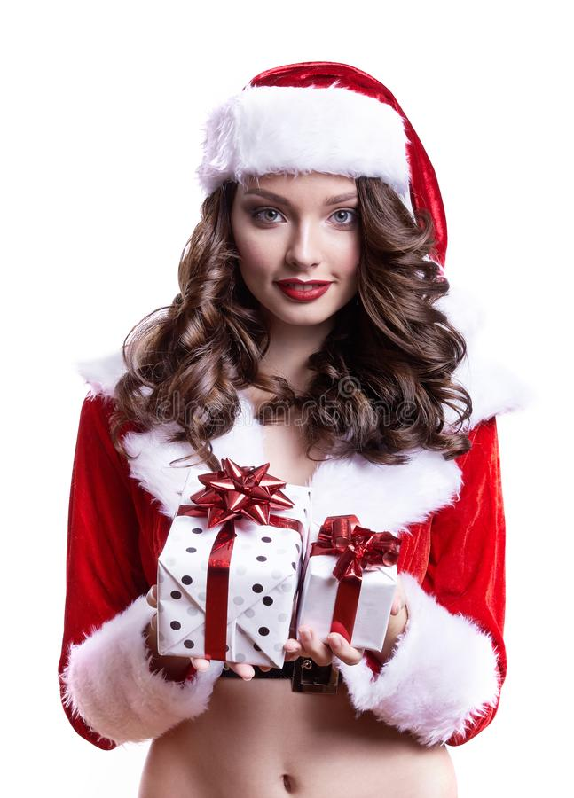 Beautiful young Santa girl with gifts on white background. royalty free stock photos