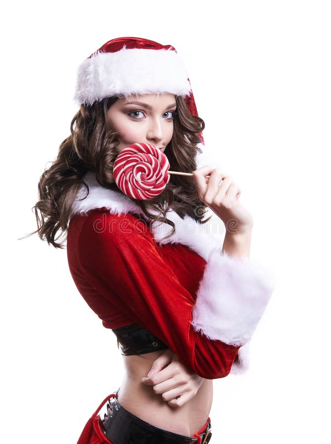 Beautiful young Santa girl with candy on white background. royalty free stock images