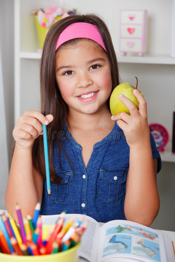 Free Beautiful Young School Girl Eating An Apple Stock Image - 43706761