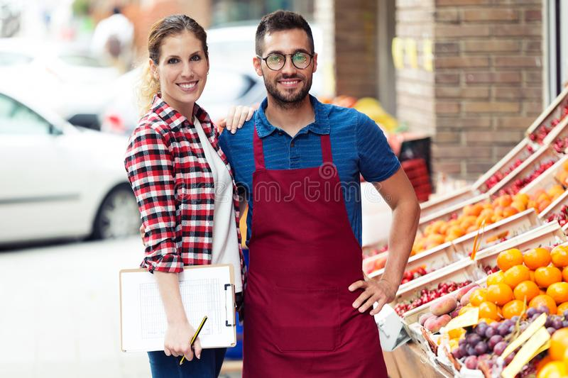 Beautiful young sellers looking at camera in health grocery shop. stock photo