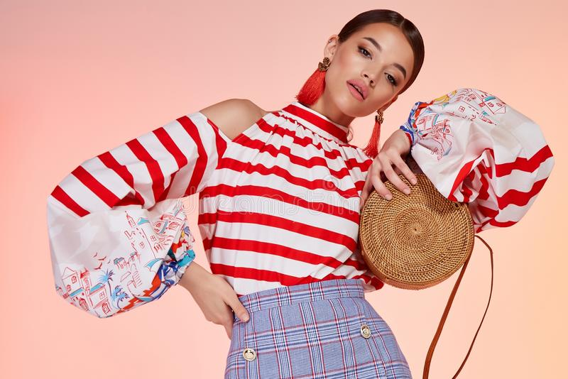 Beautiful young brunette woman portrait background, makeup stock photo