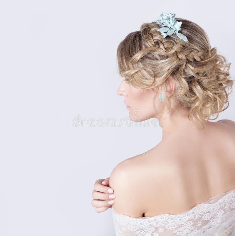 Beautiful young elegant sweet girl in the image of a bride with hair and flowers in her hair , delicate wedding makeup stock photos