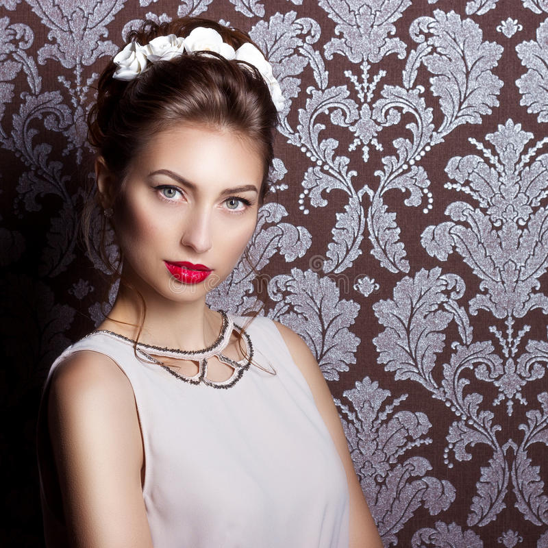 Beautiful young elegant woman with red lips beautiful stylish download beautiful young elegant woman with red lips beautiful stylish hairstyle with white flowers in mightylinksfo