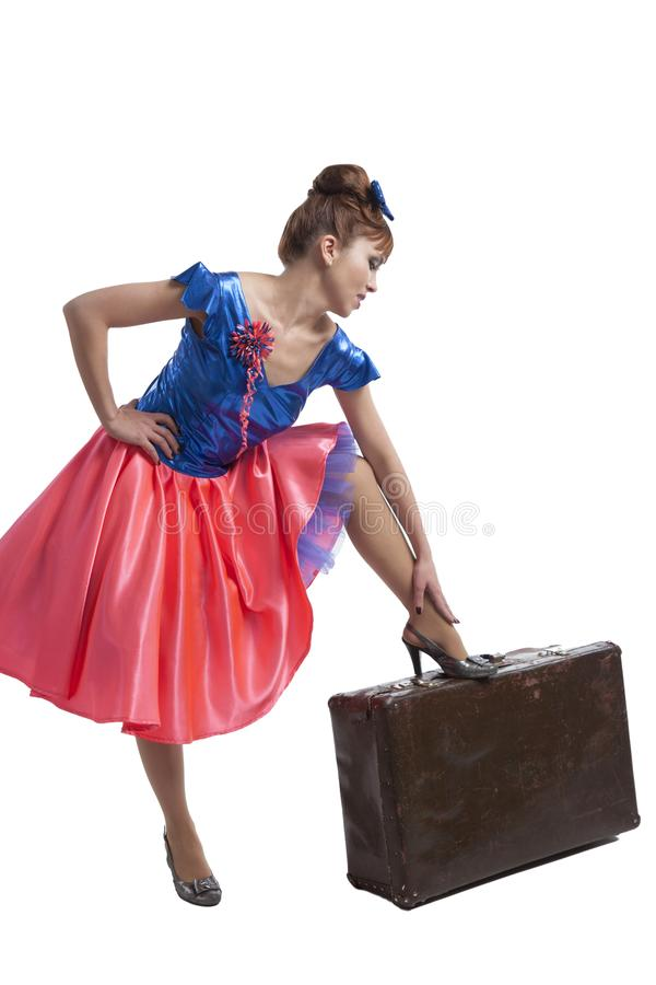 Beautiful woman with a retro suitcase. Beautiful young white woman in short skirt with beautiful legs posing on white background with retro suitcase stock photos
