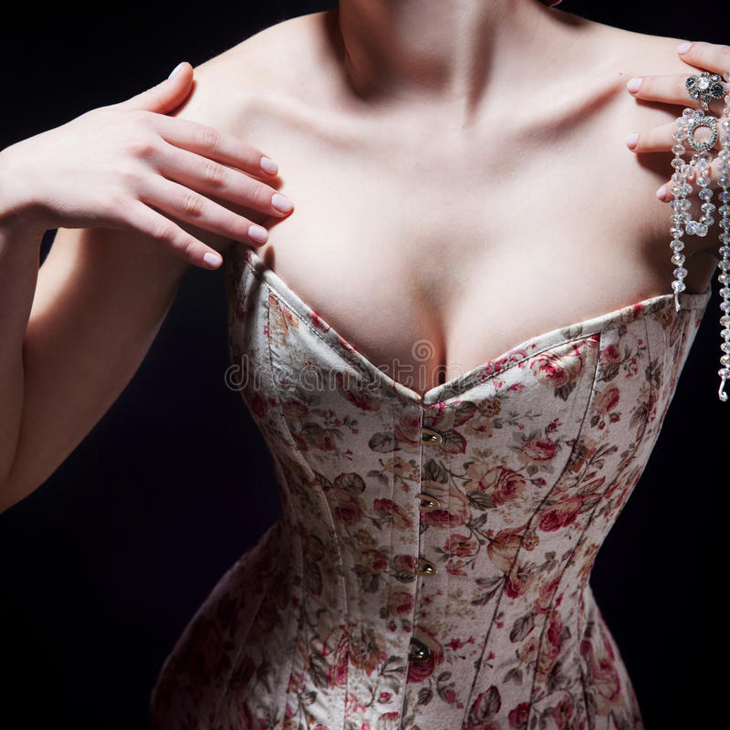 Download Beautiful Young Woman In A Corset With Floral Pattern Stock Photo - Image: 83720263