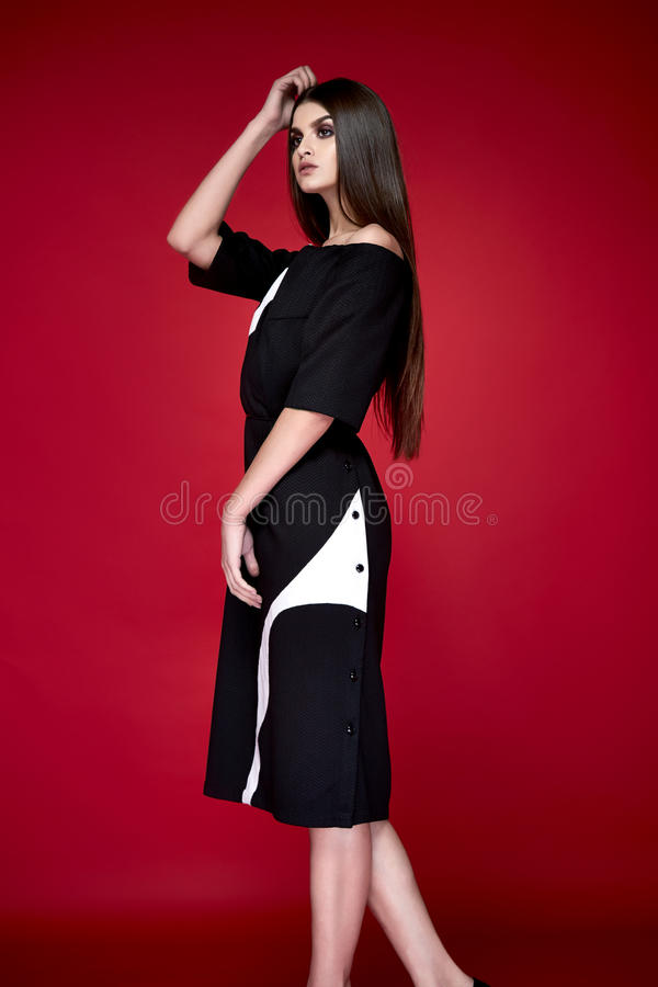 Beautiful young woman with long hair brunette perfect sport thin figure tanned body make-up wearing a dress suit skirt collec royalty free stock photo