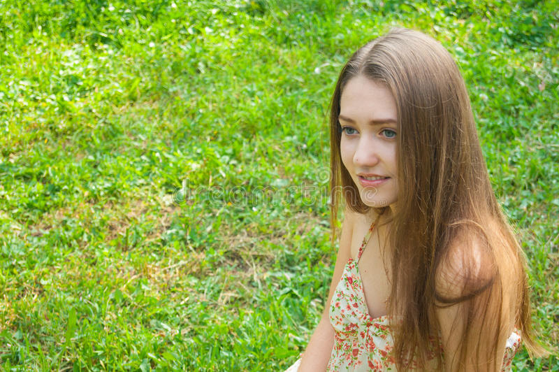 Beautiful young smiling girl outdoors. stock photography