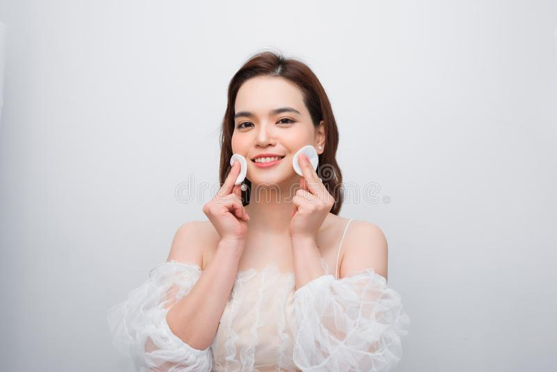 Beautiful young smiling woman with clean cotton pads . Facial treatment. Beauty skin care famale face . Expressive facial. Expressions royalty free stock photos