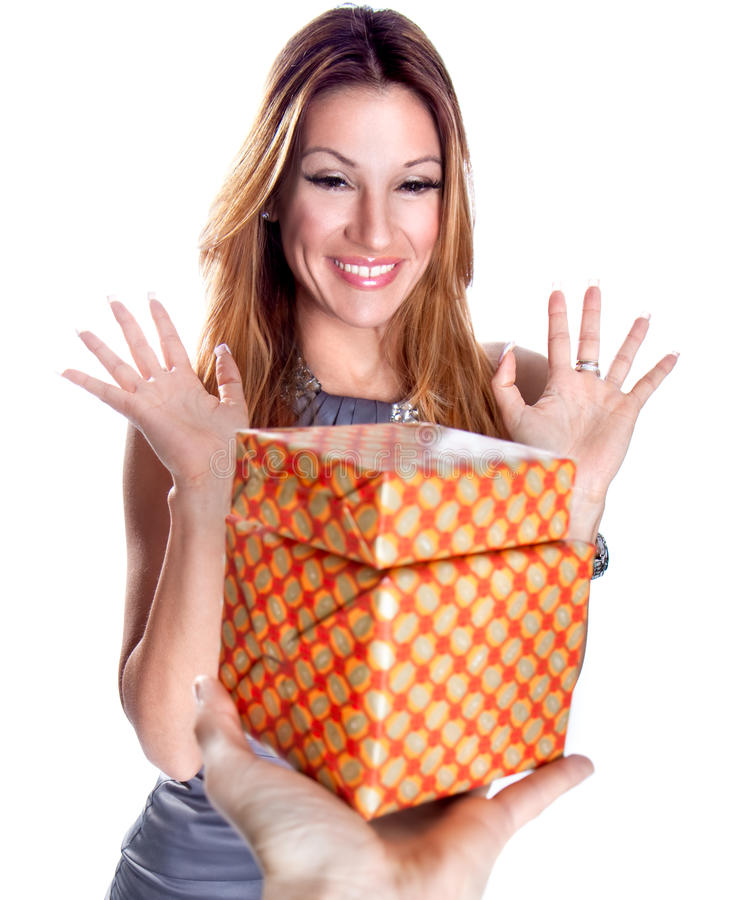 Beautiful young smiling woman with a gift royalty free stock photos