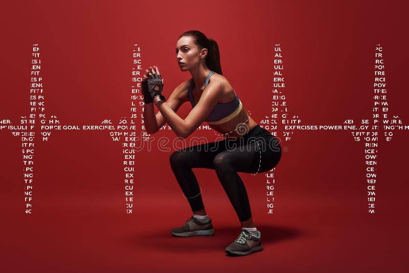 Never give up. Sportswoman standing over red background, stretching her body. Graphic drawing. royalty free stock photo