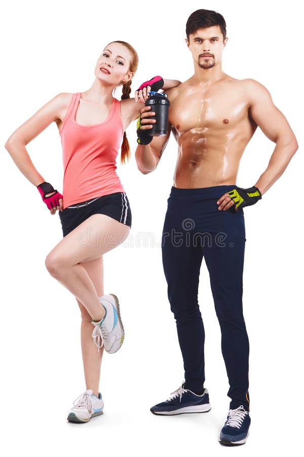 Beautiful young sporty couple showing muscle isolated on a stock photo