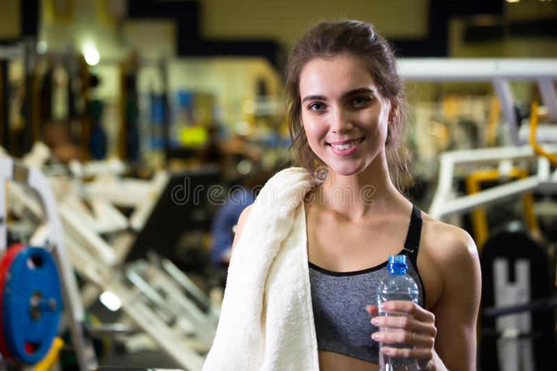 Download Beautiful Young Sporty Woman. Fitness Girl Training In Sport Club With Exercise Equipments. Stock Photo - Image: 83705897