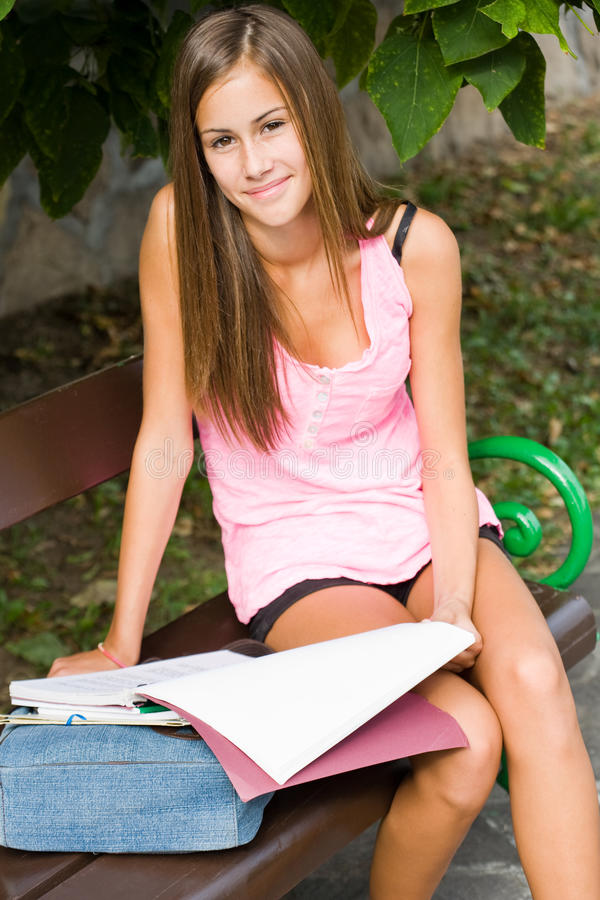 Download Beautiful Young Student Girl Studying Outdoors. Stock Photo - Image: 26381570