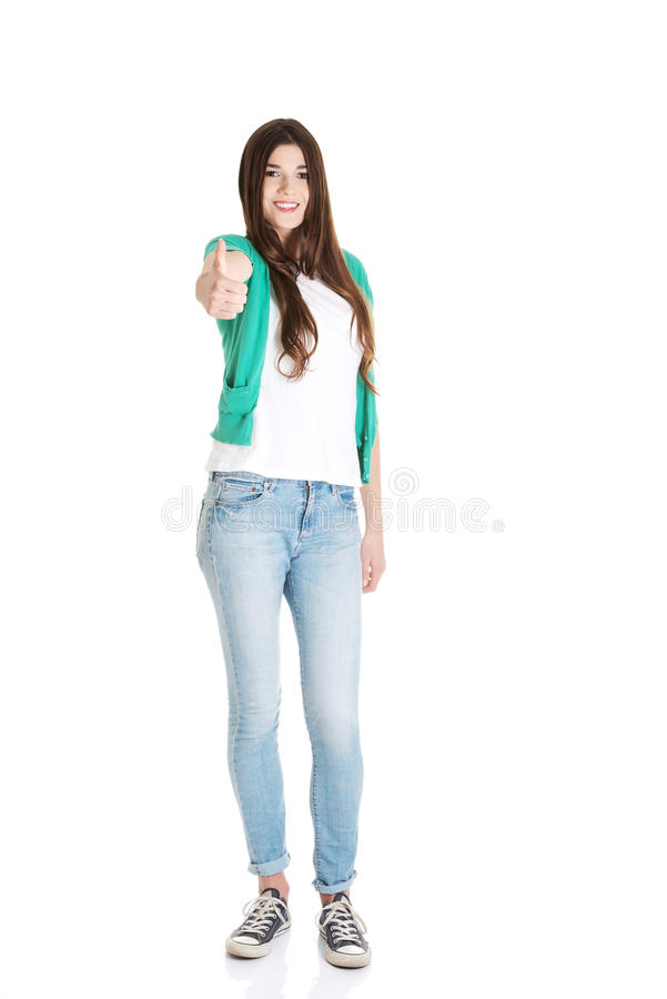 Beautiful young student showing OK. royalty free stock image