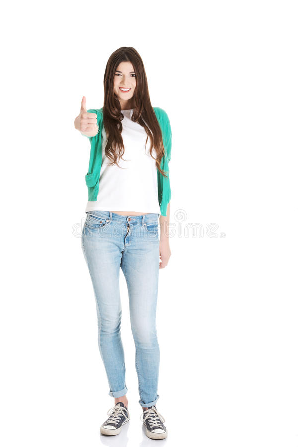 Beautiful young student showing OK. royalty free stock photos
