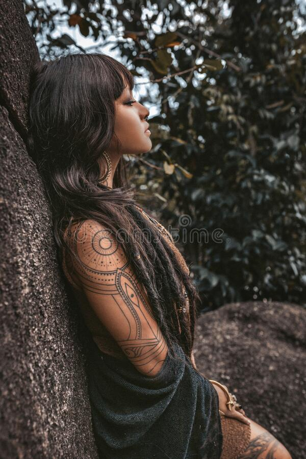 Beautiful young stylish tribal style woman outdoors portrait imagens de stock royalty free