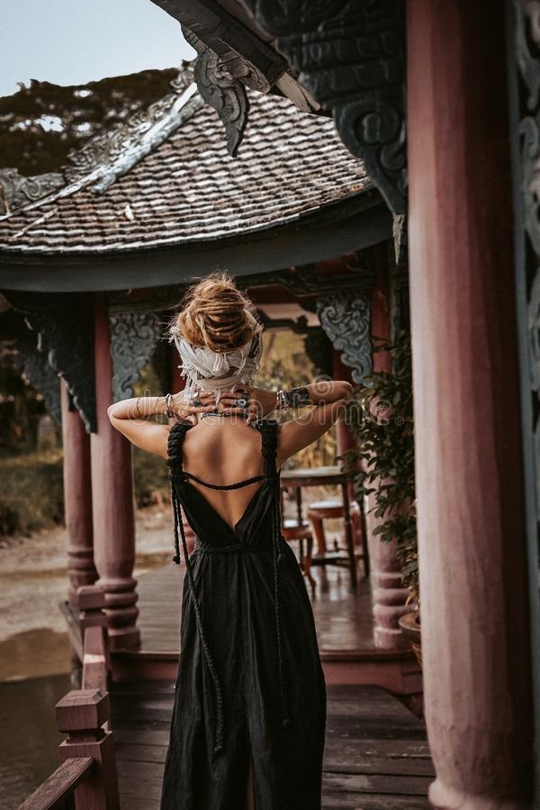 Beautiful young stylish woman wearing turban outdoors portrait stock photography