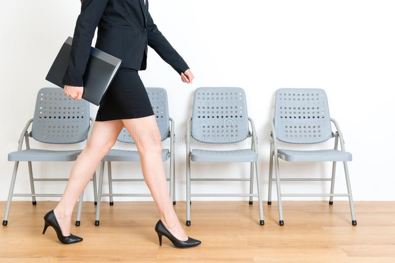 Young suit female model holding company data file stock photos