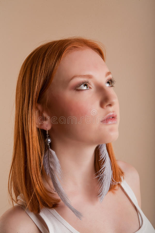Beautiful young surprised girl with redhair