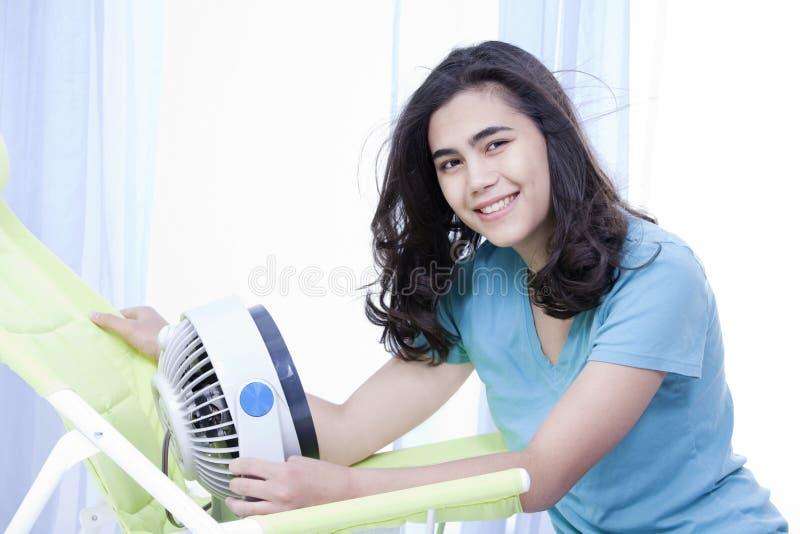 Download Beautiful Young Teen Enjoying Cool Fan Breeze Stock Photo - Image: 26835170