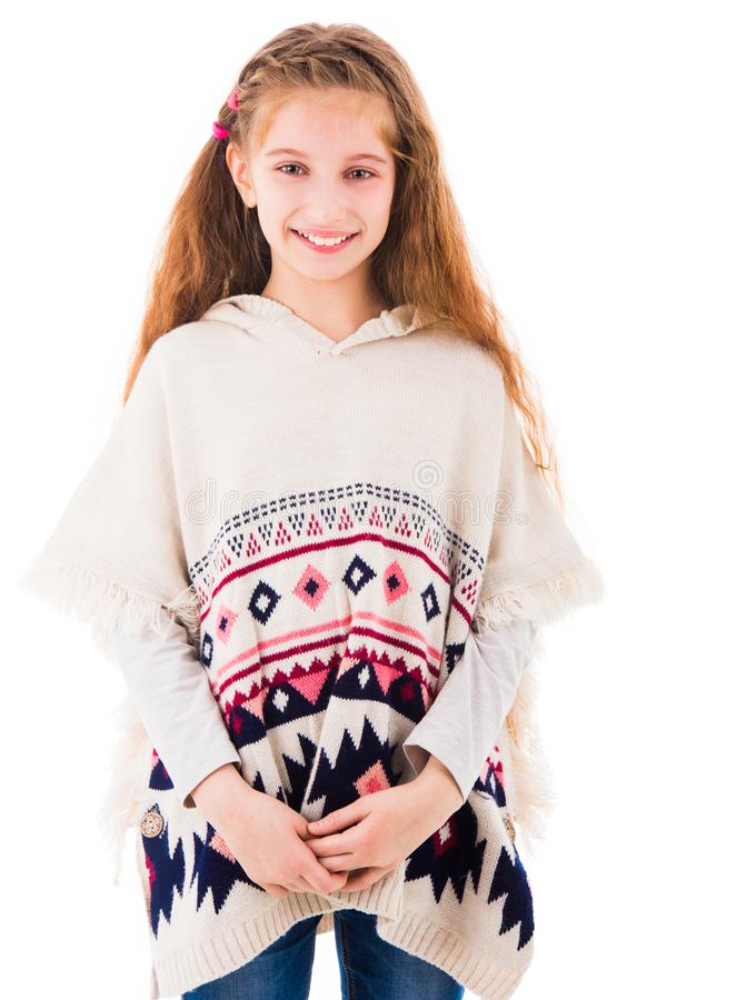 Young teen girl in poncho royalty free stock photos