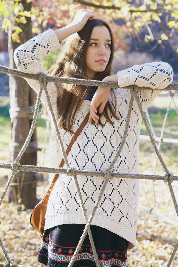 Free Beautiful Young Teenage Girl Posing Near A Rope Fence Stock Image - 50078841