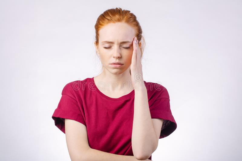 Beautiful young touching her temples feeling stress, on white background royalty free stock photos