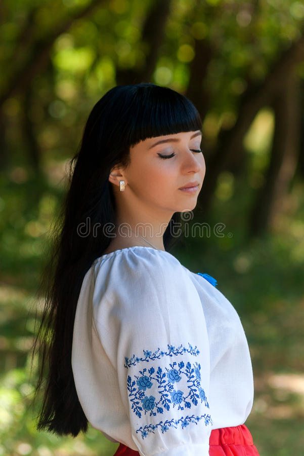 Beautiful young Ukrainian girl in national costume. Girl with beautiful appearance in the woods on the nature. Portrait. stock photography