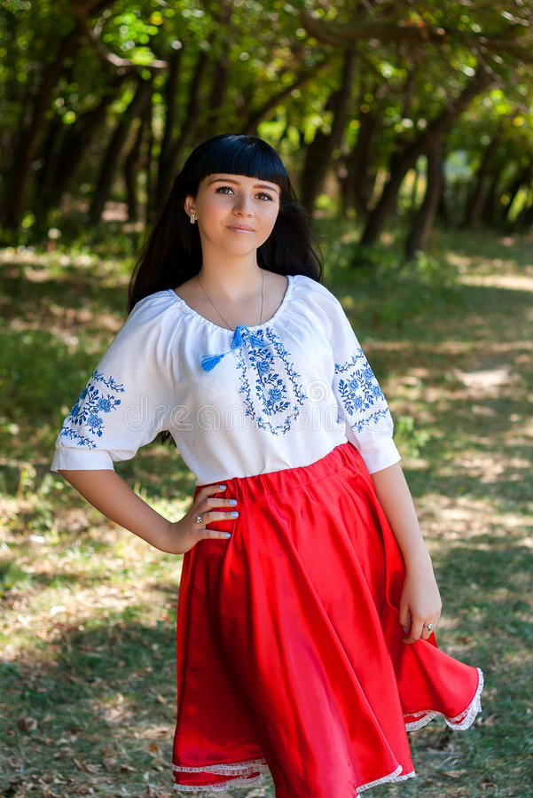 Beautiful young Ukrainian girl in national costume. Girl with beautiful appearance in the woods on the nature. Portrait. stock image