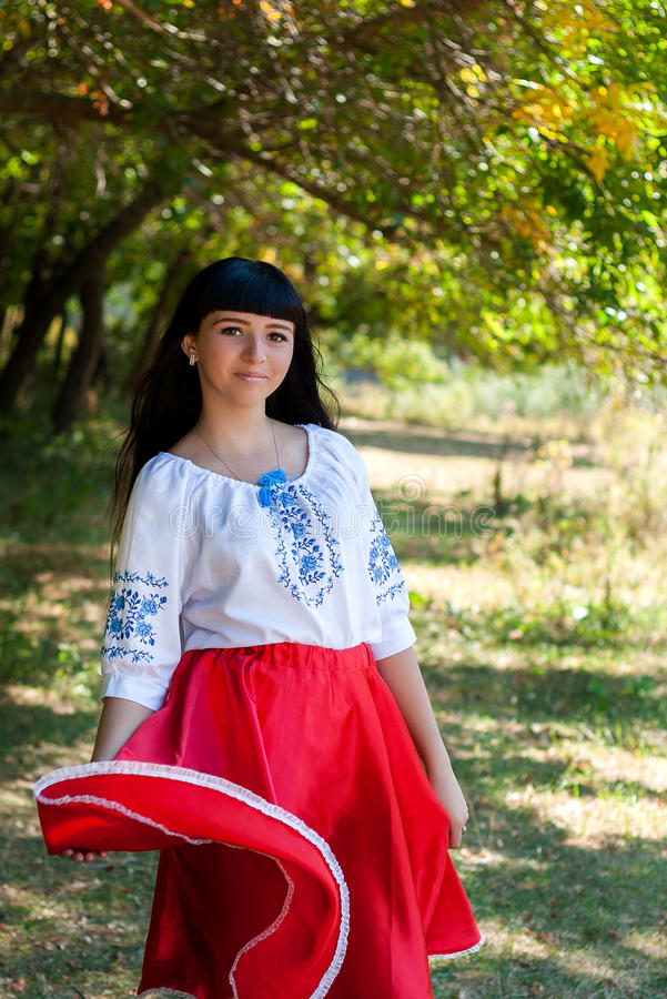 Beautiful young Ukrainian girl in national costume. Girl with beautiful appearance in the woods on the nature. Portrait . stock image
