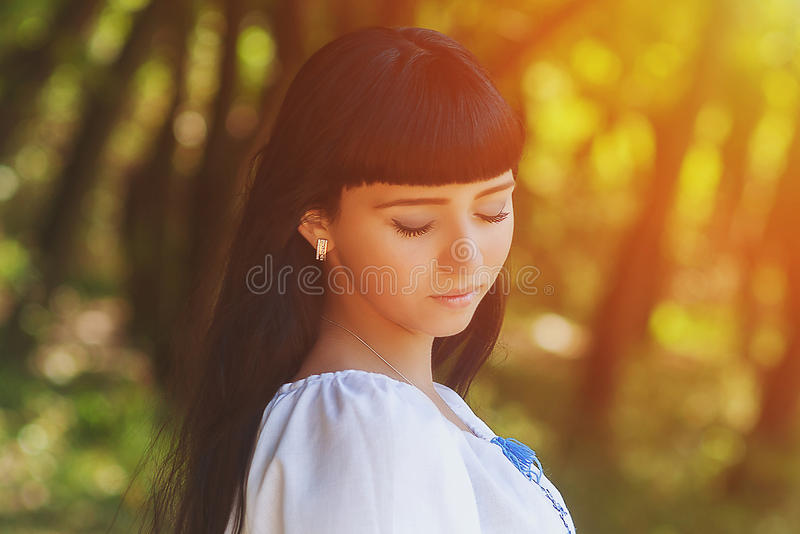 Beautiful young Ukrainian girl in national costume. Girl with beautiful appearance in the woods on the nature. Portrait. stock images