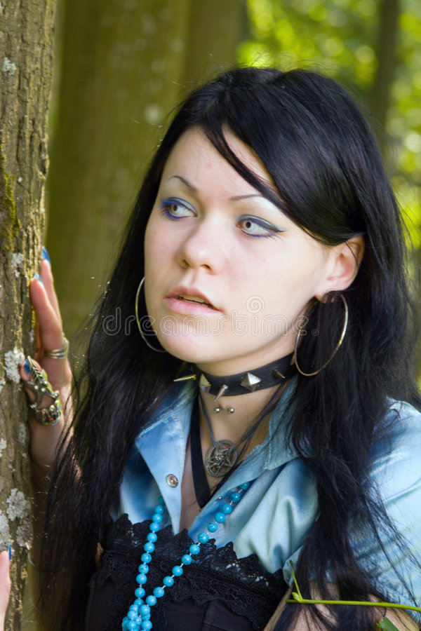 Beautiful young vampire girl. In the forest stock images