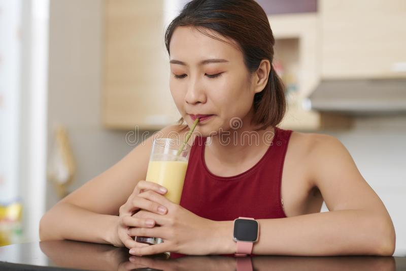 Vietnamese woman sipping fruit cocktail royalty free stock photo