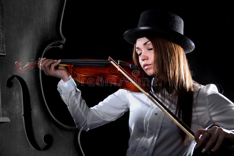 Beautiful young violinist royalty free stock images