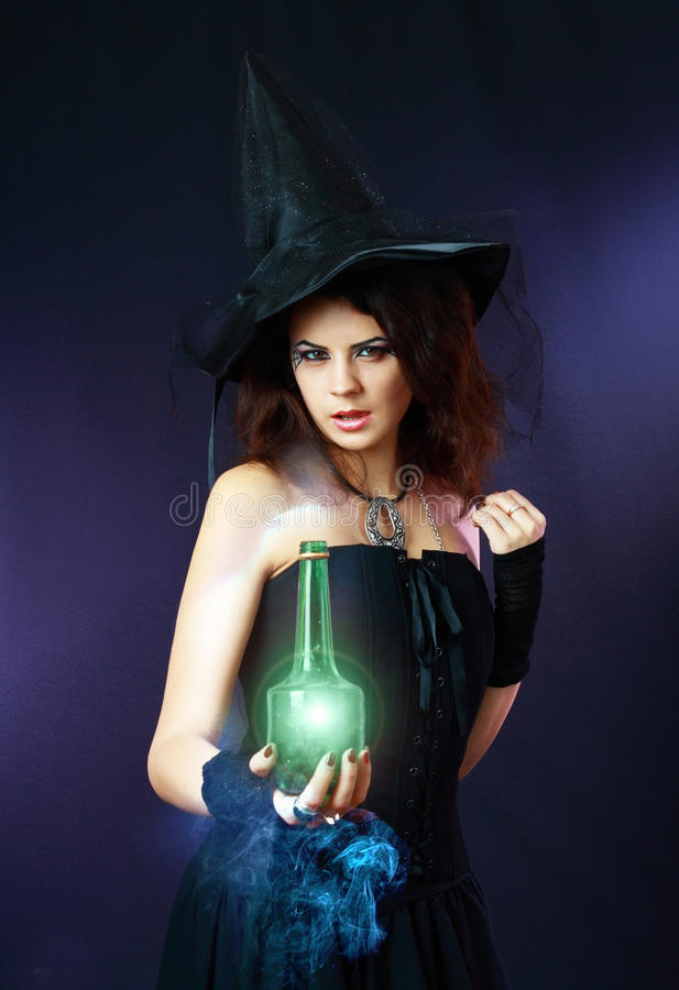 Beautiful young witch stock photo
