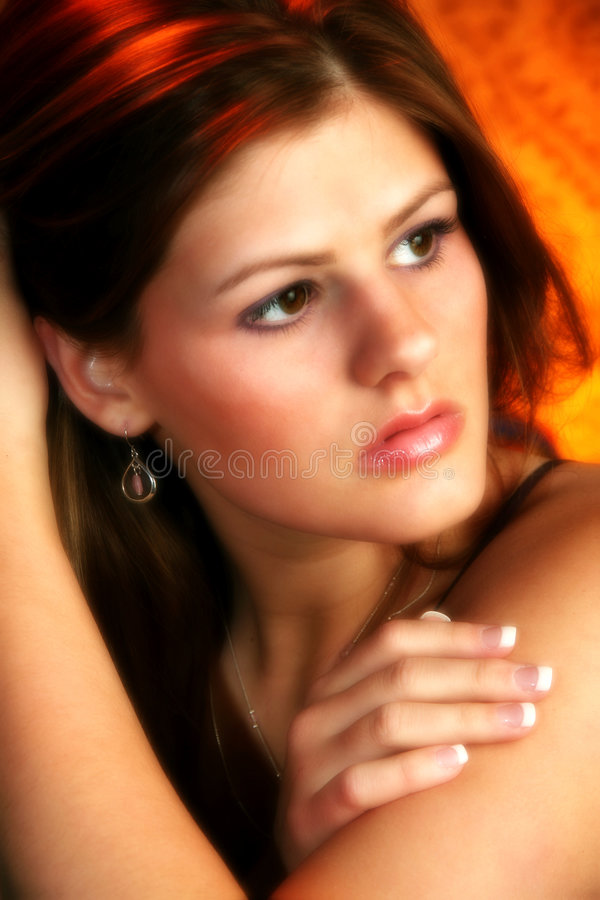 Beautiful Young Woman. Portrait of a beautiful nineteen year old woman. Main focus on left eye royalty free stock photography