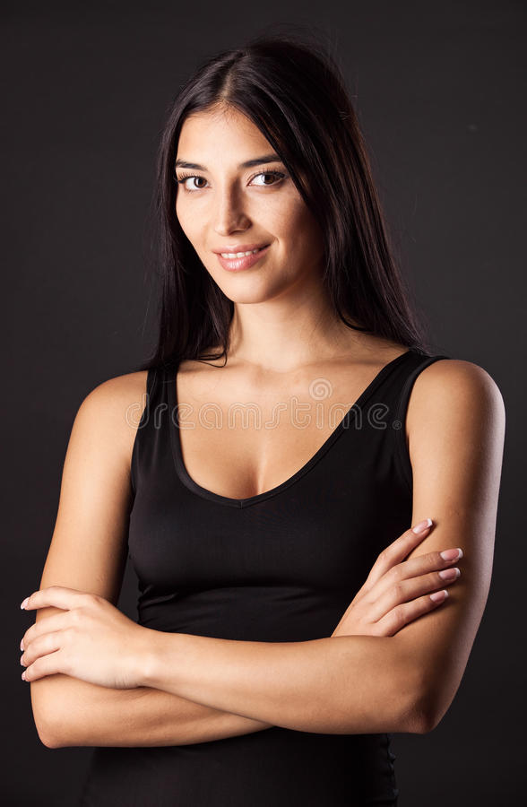 Beautiful young woman against black royalty free stock image