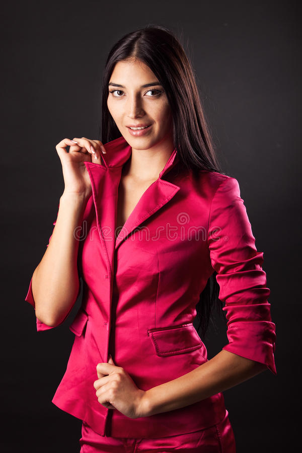 Beautiful young woman against black stock photography