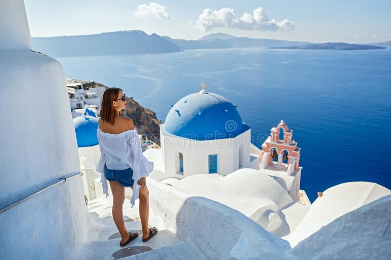 Beautiful young woman against  Santorini stock photography