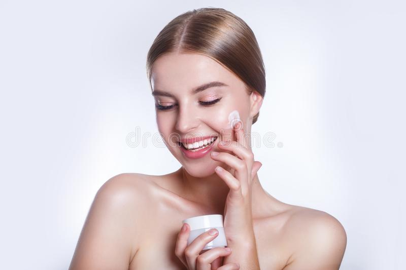 Beautiful Young Woman with Clean Fresh Skin touch own face . Facial treatment . Cosmetology , beauty and spa . royalty free stock images